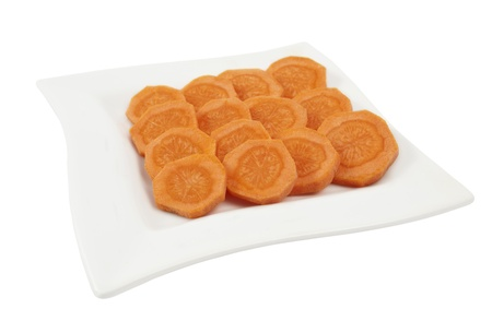 bisected: carrots cut into circles on a white background Stock Photo