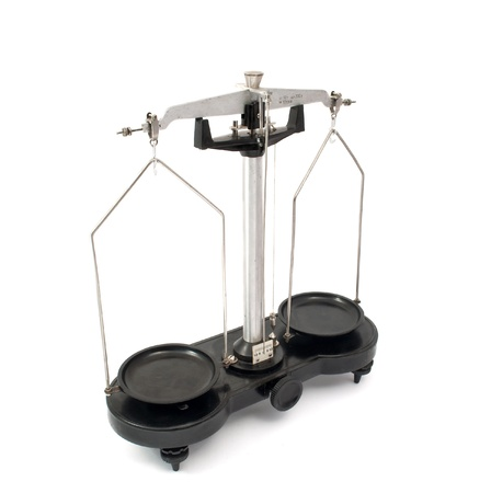 an ounce: old laboratory scales on a white background Stock Photo