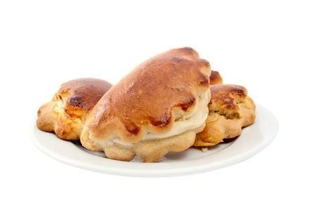 teacake: patties with cheese on a white background