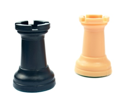 battling: chess pieces on a white background