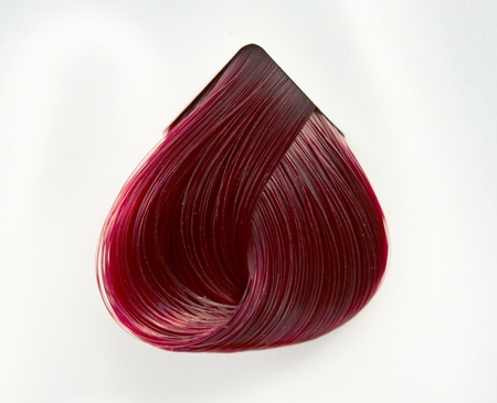 strand of hair: a strand of hair color on a gray background