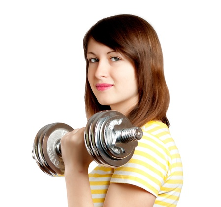 Girl with dumbbells on white background photo