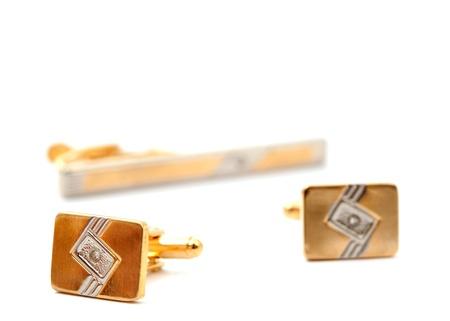 cufflinks on a white background photo
