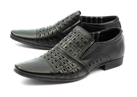 shoe shine: black shoes on white background Stock Photo