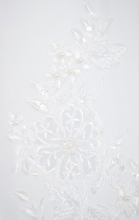 bead embroidery: texture of a white wedding dress Stock Photo