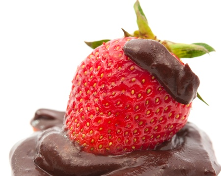 decadence: strawberries in chocolate glaze on a white background Stock Photo