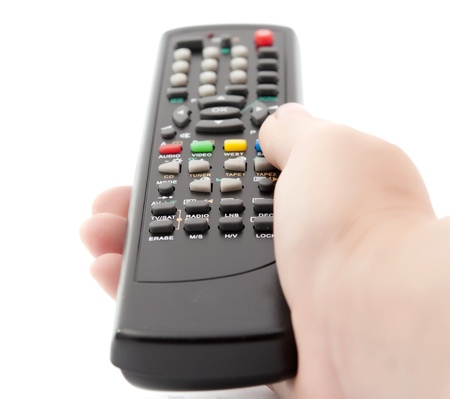 telly: TV remote control in hand on white background