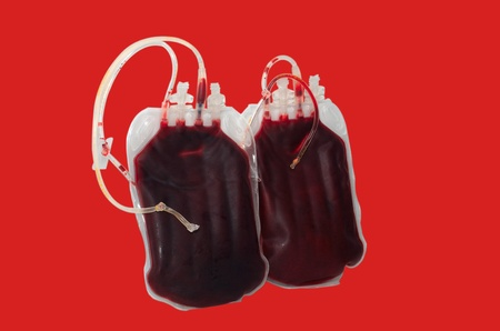 bags of blood on a red background photo
