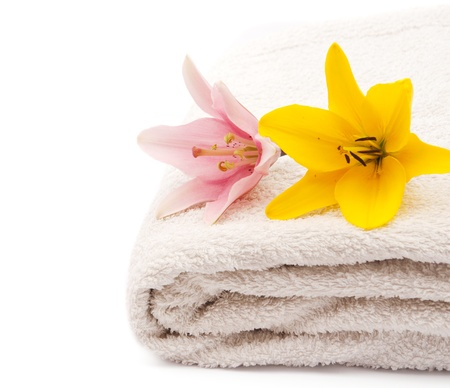 lily and towel on a white background photo