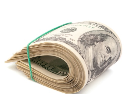pile papier: dollars sur un fond blanc Banque d'images
