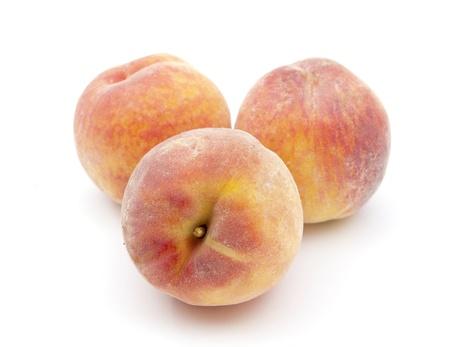 peach on a white background photo