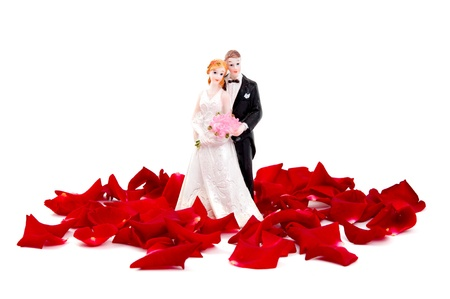 Bride and groom of rose petals on white background Stock Photo