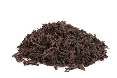 dry black tea on a white background