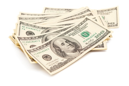 stack of paper:  dollars on a white background Stock Photo