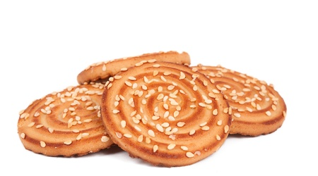 Biscuits with sesame seeds on a white background photo