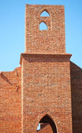 Construction of the church against the blue sky photo