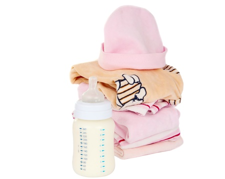 clothing and baby milk bottle on a white background photo