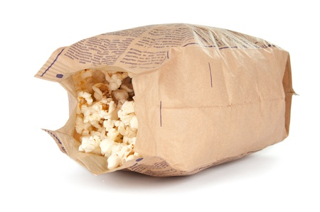 popcorn in a paper bag on white background photo