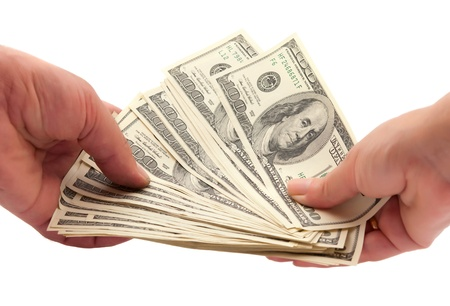dollars in a human hand on a white background photo