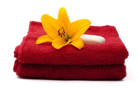 red towel with lily on a white background photo