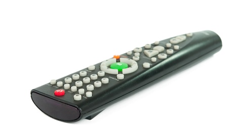 Black TV remote control on a white background photo