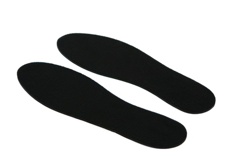 inner wear: black insoles isolated on white background Stock Photo