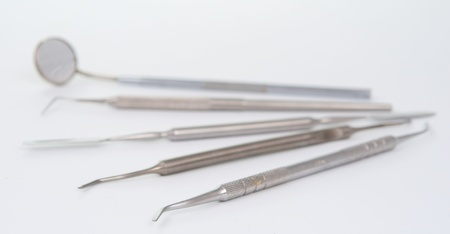 angled view: dental tool on a grey background