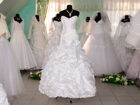 gown: Some wedding dresss in a dress shop