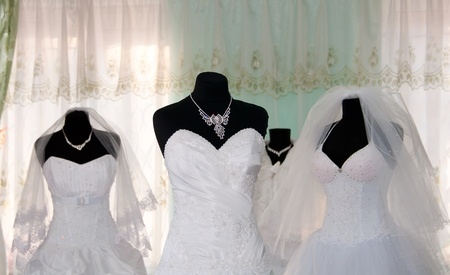 Some wedding dress's in a dress shop photo