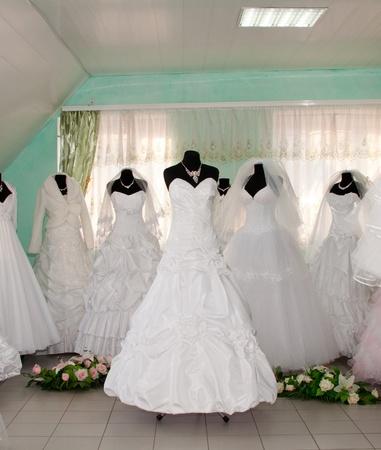 Some wedding dresss in a dress shop