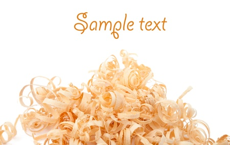 Wood shavings on white background with copy space. Macro with shallow dof.