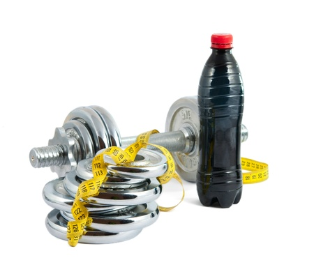 dumbbell with a measuring tape on white background photo