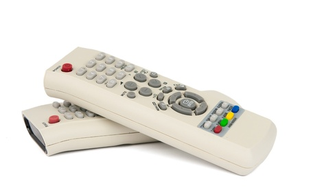 remote controls: TV remote controls on a white background Stock Photo