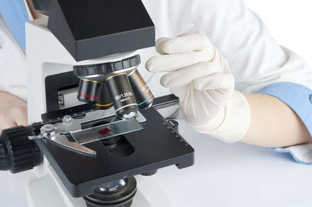 biochemist: testing of the microscope in the laboratory