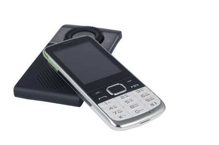 handsfree telephones: mobile phone with a headset on a white background
