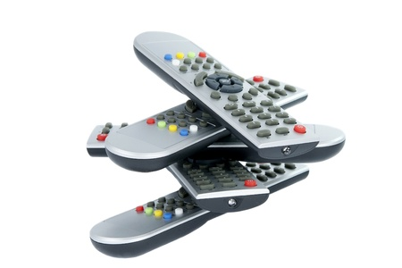 remotes: Gray TV remotes isolated on white background