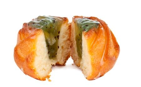 cake with fruit filling isolated on white background photo