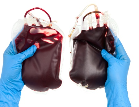 bag of blood in hand isolated on white background photo