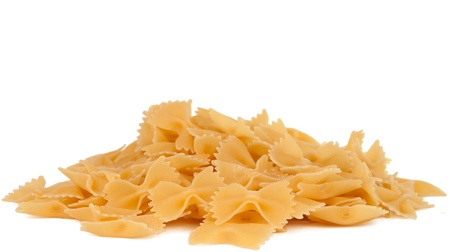 staple food: Heap Farfalle pasta isolated on white background. Pasta is a staple food of traditional Italian cuisine.