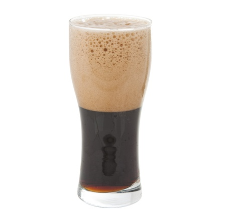 a glass of dark beer isolated on white background photo