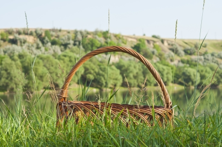 empty picnic basket on the green grass photo