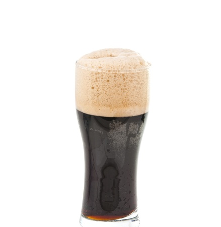unstrained: a glass of dark beer isolated on white background