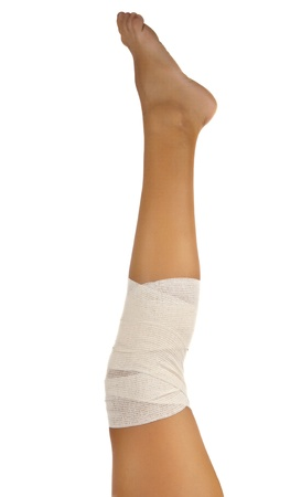 injured ankle with bandage on a white background Stock Photo - 14804936
