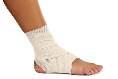 articulation: injured ankle with bandage on a white background Stock Photo
