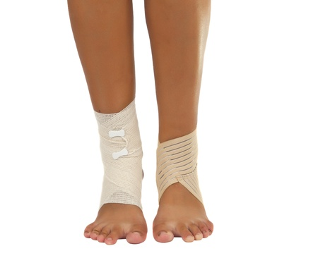 injured ankle with bandage on a white background photo