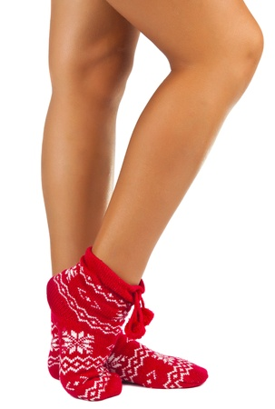 legs female in striped socks isolated on white background photo