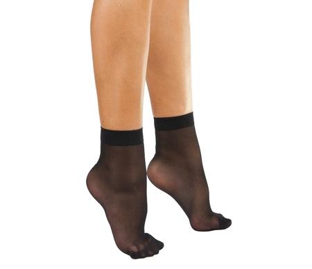 Black nylon socks female feet. Isolated on white background