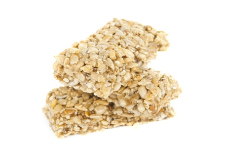 Kozinaki of sesame on a white background photo