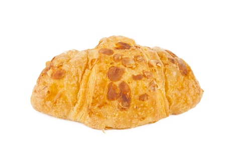 croissant with nuts isolated on white background photo