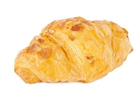 flaked: croissant with nuts isolated on white background